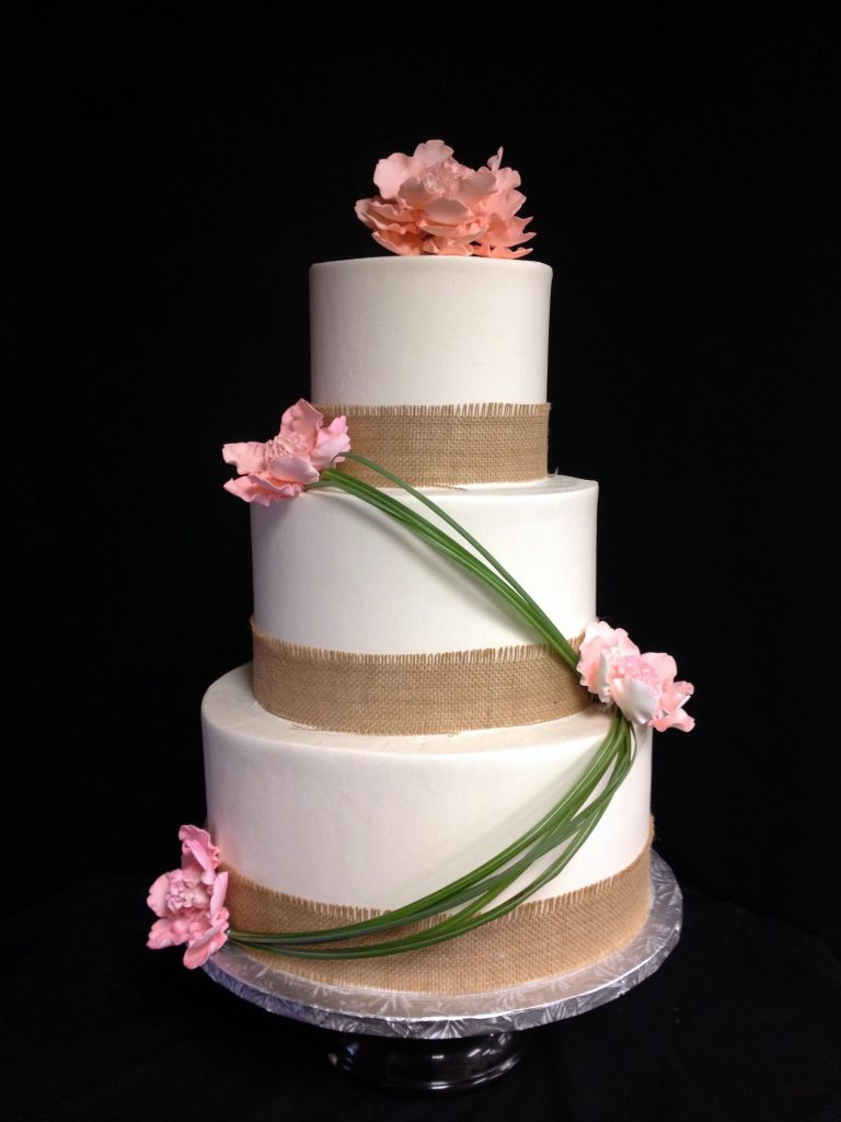 wedding cakes-burlap with sugar flowers and grasses